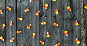 Candy corn on gray wood table
