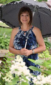 Michelle Dallacheisa with umbrella outside