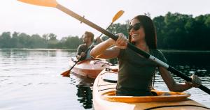Man and woman kayaking on lake